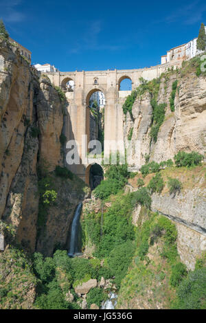 Puente Nuevo and El Tajo Gorge plus waterfall in the City of Ronda in Spain's Malaga province, Andalusia - Stock Photo