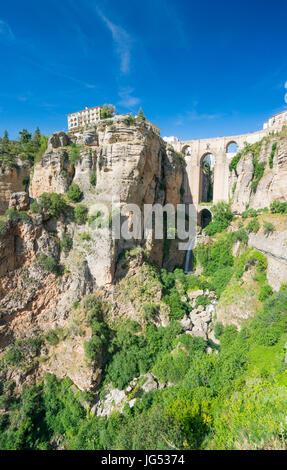 Parador,  Puente Nuevo and El Tajo Gorge in the City of Ronda in Spain's Malaga province, Andalusia - Stock Photo