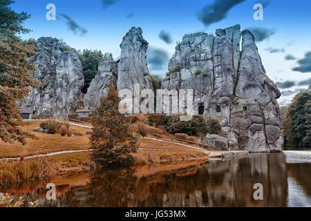 The Externsteine, striking sandstone rock formation in the Teutoburg Forest, Germany, North Rhine Westphalia - Stock Photo
