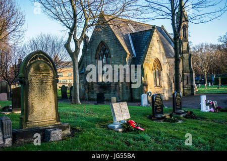 A historic old stone chapel situated in a cemetery among gravestones. Jesmond, Newcastle upon Tyne, Tyne and Wear, - Stock Photo