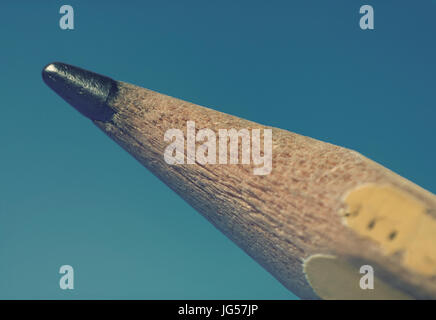 Used Pencil Tip Macro on the Turquoise Background - Stock Photo