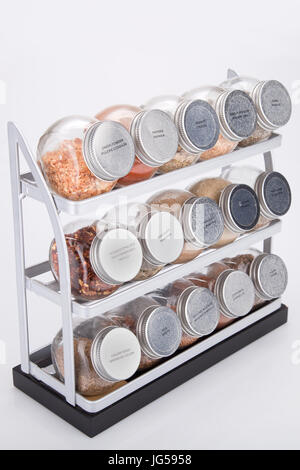 Spices shelves on a white surface. Spice rack isolated on white background. - Stock Photo