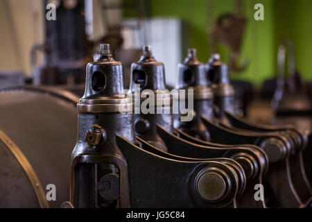 Vintage mining winch empowered by steam engine. Pistols and valves. - Stock Photo