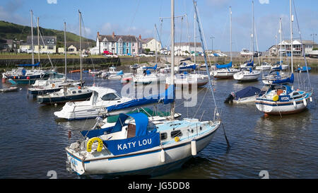 Yachts riding at anchor in Aberaeron Harbour, Ceredigion, Wales, UK - Stock Photo