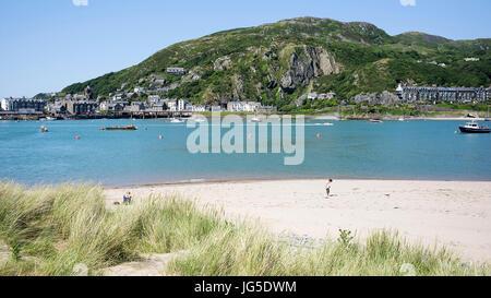 Inspecting the beach at Penrhyn Point, Barmouth, Gwynedd, Wales, UK - Stock Photo