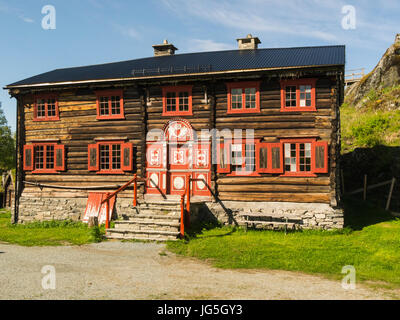 Typical Norwegian Wooden Farm House And Red Barn Reflected