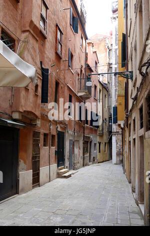 One of many narrow alleys in Venice, Italy - Stock Photo