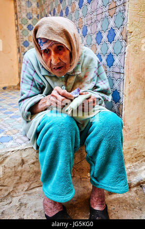 A beggar in the alleys of the old city of Fez, Morocco - Stock Photo