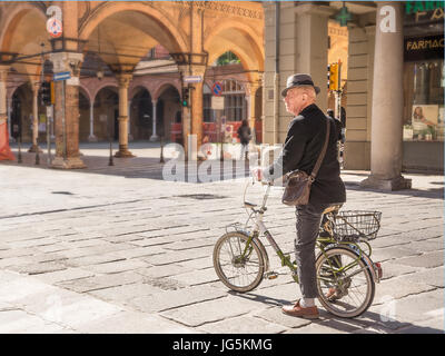 Bologna, Italy - April 22, 2017: Senior bicycle man in the center of bologna in a sunny day - Stock Photo