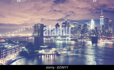 Vintage toned picture of New York City skyline at night, USA. - Stock Photo