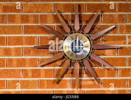 Vintage clock on a brick wall full view of clock - Stock Photo
