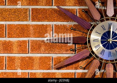 Vintage clock on a brick wall right side cut off - Stock Photo