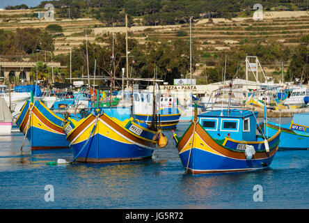 Malta: Colourfull fishing boats in the Marsaxlokk harbour - Stock Photo