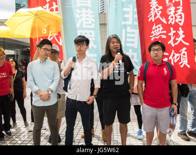 HONG KONG, CHINA - JULY 03: Joshua Wong Chi-fung (2nd left),the Hong Kong student activist and secretary general - Stock Photo