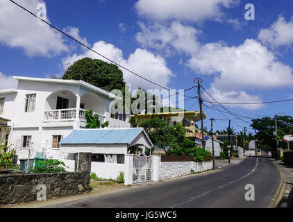 Grand Baie, Mauritius - Jan 11, 2017. Houses in Grand Baie, Mauritius. Mauritius was a British colonial possession - Stock Photo
