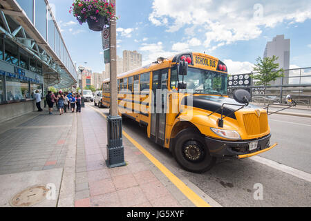 Toronto, Canada - 26 June 2017: Yellow school bus parked in Toronto Downtown - Stock Photo