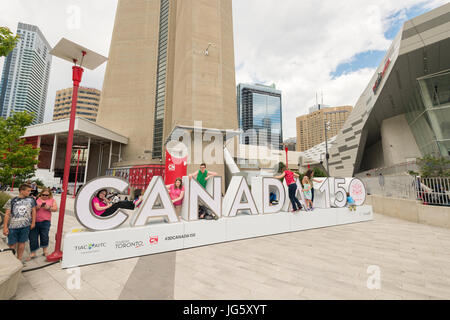 Toronto, Canada - 26 June 2017: Canada 150 sign at the bottom of CN tower - Stock Photo