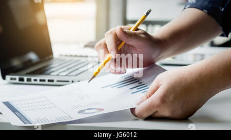 business managers working with new startup in modern loft.Analyze reports,plans - Stock Photo