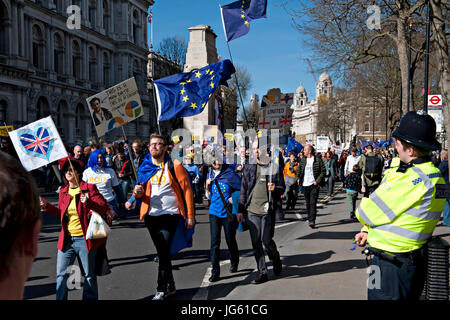 Demonstrators gather in Westminster following a march from Park Lane to demonstrate opposition to the UK's forthcoming - Stock Photo