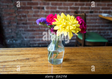 flowers class vase on restaurant table - Stock Photo
