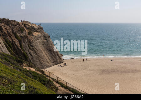 Malibu, California, USA - June 29, 2017:  View of rock climbing cliff at Westward Beach in Point Dume State Park. - Stock Photo