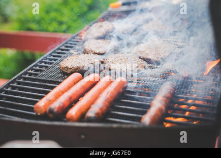 Food cooks on a grill in summer - Stock Photo