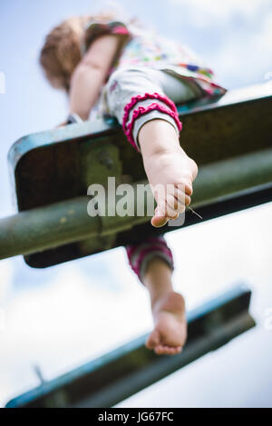 A child plays at a playground - Stock Photo