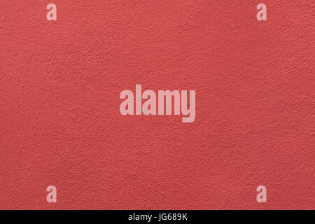 Red painted stucco wall. Background texture. - Stock Photo