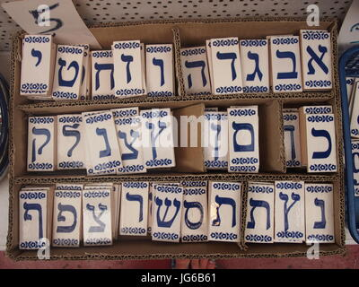 Tiles with the Hebrew alphabet on - Stock Photo