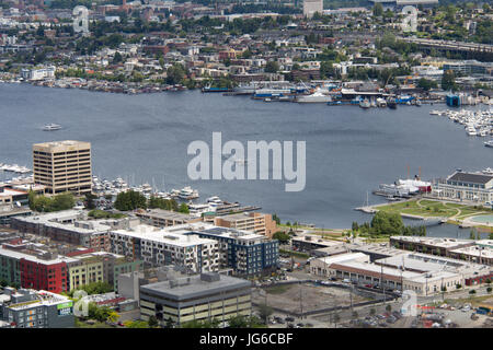 View on Lake Union from the Space Needle in Seattle, Washington with a seaplane landing on the water - Stock Photo