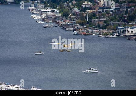 Seaplane is taking off from Lake Union in Seattle, Washington - Stock Photo