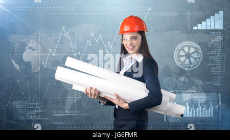 Building, developing, consrtuction and architecture concept -businesswoman in orange helmet, glasses with blueprint. - Stock Photo