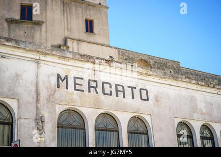 Local market building in poor Puglia, Italy - Stock Photo