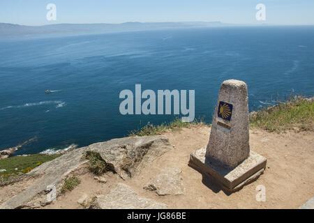 Zero kilometre milestone of the Camino de Santiago (Way of Saint James) on the coast of the Atlantic Ocean on Cape - Stock Photo