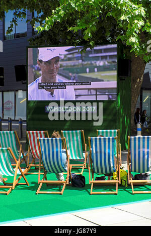 Bristol, UK. 3rd July, 2017. On the first day of Wimbledon, tennis fans watch coverage of the tournament on an open - Stock Photo