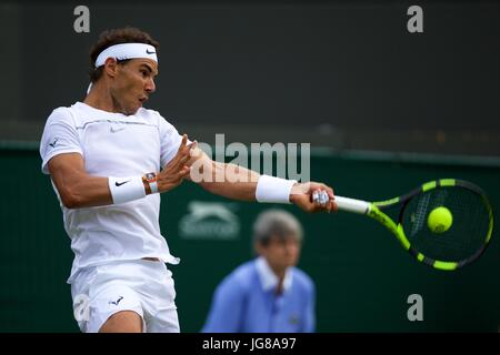 London, UK. 3rd July, 2017. Rafael Nadal of Spain returns the ball during the men's singles first round match against - Stock Photo