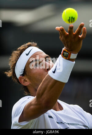 London, UK. 3rd July, 2017. Rafael Nadal of Spain serves during the men's singles first round match against John - Stock Photo