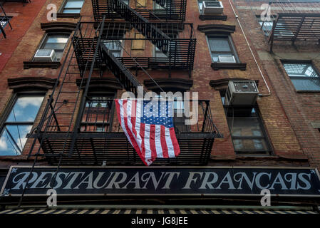 New York, NY, USA. 4th July, 2017. On Prince Street in Soho, some Restaurant Francais marked Independence Day with - Stock Photo