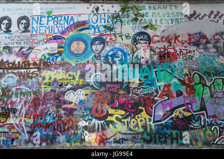 John Lennon Wall in Prague, Czech Republic. It's a wall with pieces of lyrics from Beatles' songs and John Lennon - Stock Photo