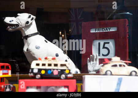 LONDON, ENGLAND - JULY 12, 2017 Many collectable old toy vehicles in bright colors on display in a window shop. - Stock Photo