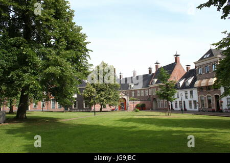 Martinikerhof cemetry & square, central Groningen, The Netherlands in summer. Luxurious Prinsenhof Hotel in background. - Stock Photo