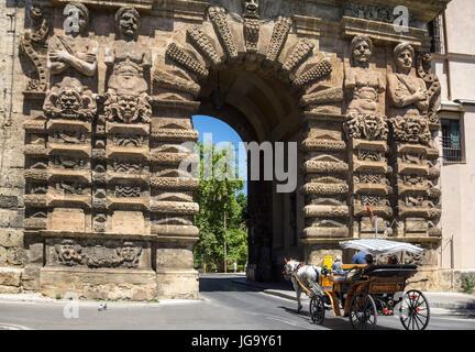 Horse and carriage passing through the 16th cen.  Porta Nuova on Corso Calatafimi. Palermo, Sicily, Italy. - Stock Photo