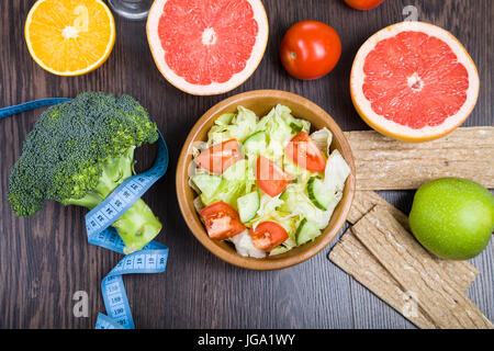 Food for diet  on a wooden table. Concept of diet and healthy lifestyle. - Stock Photo