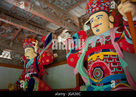 Colourful statues at the Buddhist Pohyon-temple, Mount Myohyang-san, North Korea - Stock Photo