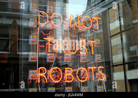 DO NOT TRUST ROBOTS neon artwork in Spacestation property development shop window Shoreditch  East London UK    - Stock Photo