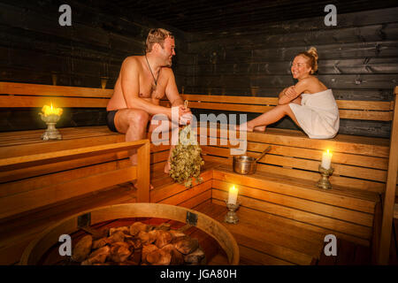 Couple in a Sauna, Lapland, Finland - Stock Photo