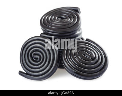 licorice candy and wheels isolated on white - Stock Photo