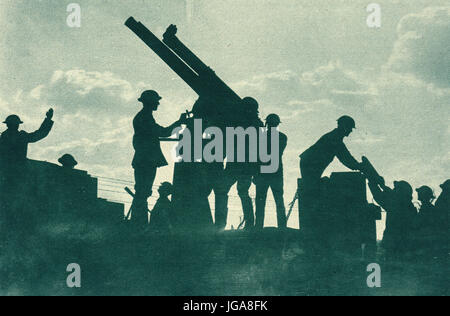 Loading Anti Aircraft Gun silhouetted against dramatic sky - Stock Photo