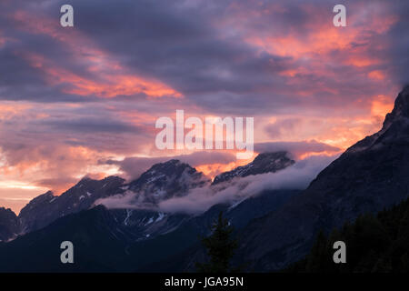 Dramatic twilight colours and clouds in the sky over the Alps and Inn valley, Tyrol, Austria - Stock Photo