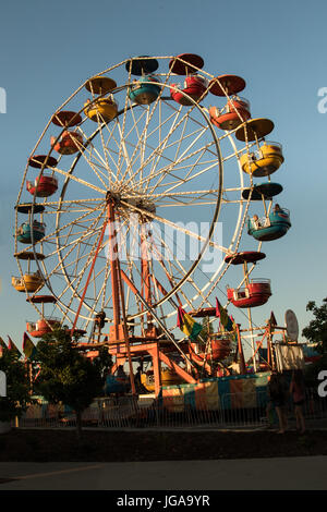 Ferris wheel at the carnival in the evening. - Stock Photo